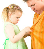 Photo of capricious girl holding father's shirt — Stock Photo