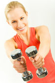 Barbells in hands — Stock Photo