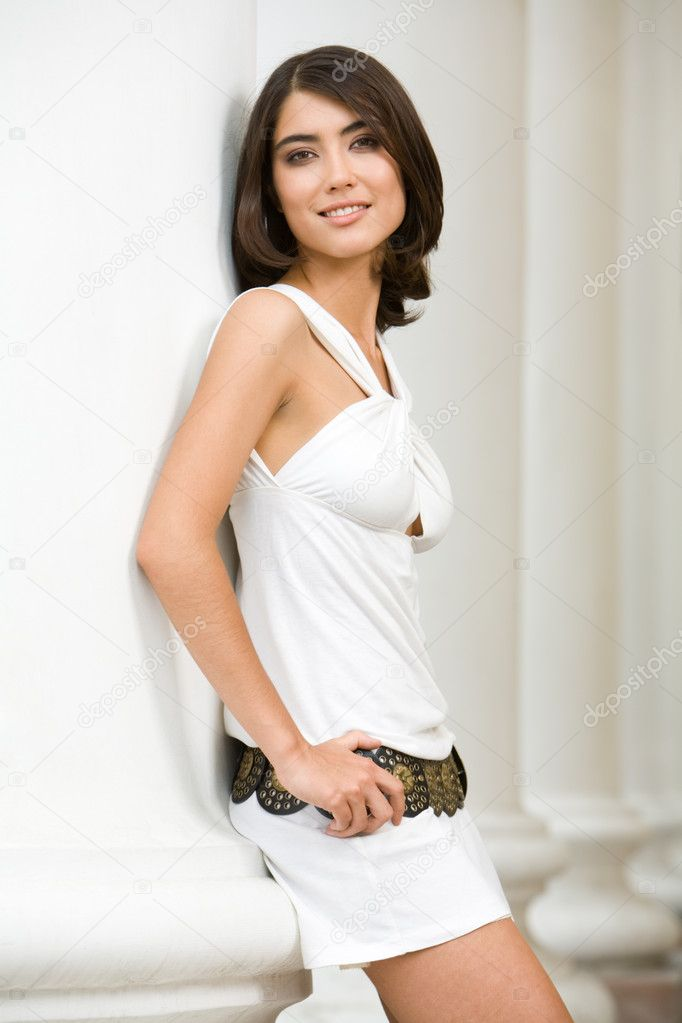 Portrait of glamour girl with brown hair standing near column  Stock Photo #11024120