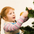 Decorating fir tree — Stock Photo #11107202