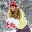 Woman holding snow — Stock Photo