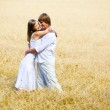 Embracing in field — Stock Photo