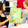 Stock Photo: Buying clothes