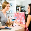 Image of salesperson selling something to attractive buyer — Stock Photo #11107915