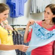 Choosing fashionable clothes - 图库照片