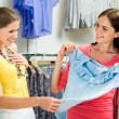 Choosing fashionable clothes — Stock Photo #11107963