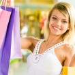 Girl with bags - Stockfoto