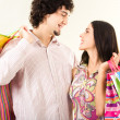 Young couple with bags — Stock Photo