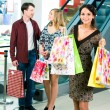 Carrying shopping bags — Stock Photo #11108153