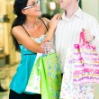 Stock Photo: Young couple in mall