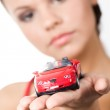 Woman holding toy car — Stock Photo #11108507