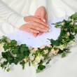 Hands with bouquet — Stock Photo #11108688