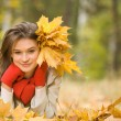 Girl with golden leaves — Stock Photo
