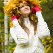 Woman in maple wreath — Stock Photo