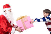 Joyful kid taking big present from Santa's hands — Stock Photo