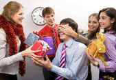 Image of man guessing what present he is going to receive from his colleagues  — Fotografia Stock