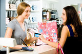 Image of salesperson selling something to attractive buyer — Stock Photo