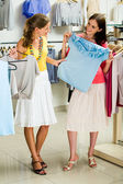 Choosing fashionable clothes — Stock Photo