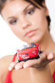 Woman holding toy car — Stock Photo