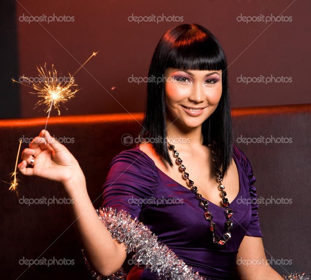 Portrait of smiling woman with Bengal light on Christmas night — Stock Photo #11104459