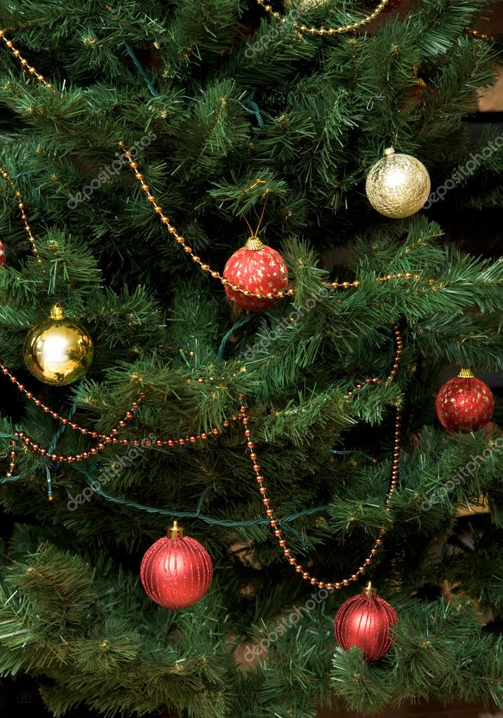 Close-up of fir tree branch with decorative balls and garlands on it — Stock Photo #11107128