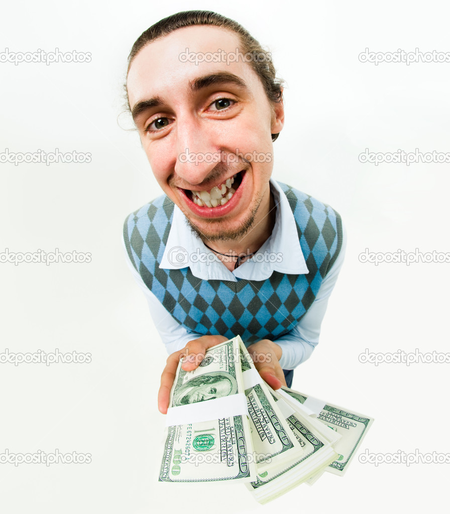 Shot of positive man with dollars in hands looking at camera with smile — Stock Photo #11107320