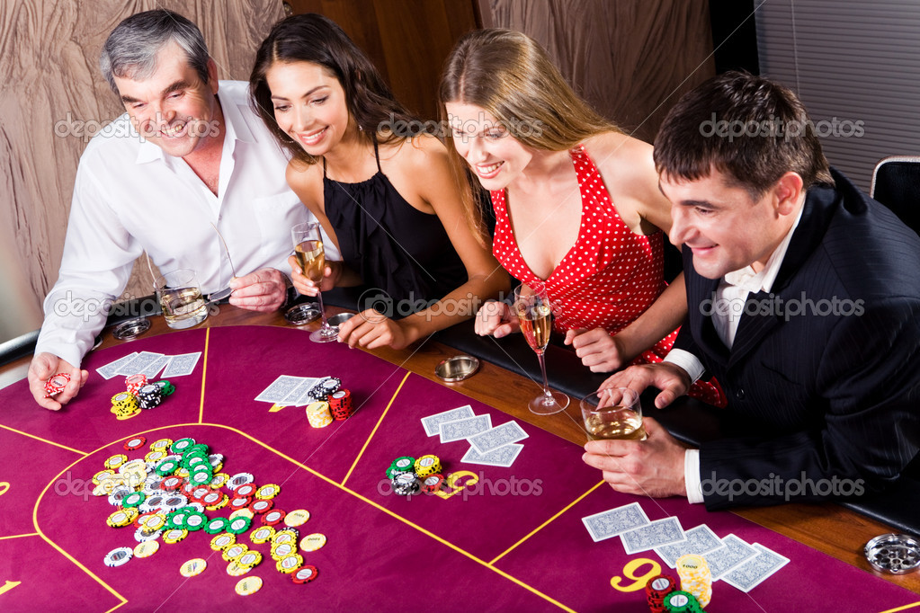 Portrait of sitting at the table and gambling — Stock Photo #11108515