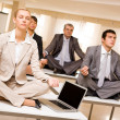 Stock Photo: Meditating business partners