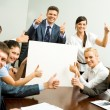Portrait of business with thumbs up holding blank cardboard and smiling at camera — Stock Photo #11125832