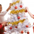Decorating Christmas tree — Stock Photo #11126334