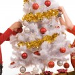 Stock Photo: Decorating New Year tree
