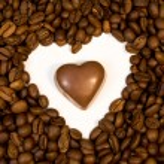 Chocolate candy inside shape of heart — Stock Photo