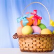 Basket with colorful eggs — Stock Photo
