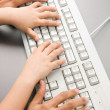 Typing together — Stock Photo