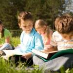 Reading outdoors — Stock Photo