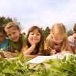 Schoolchildren outside — Stock Photo #11127132