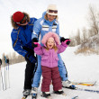 Stock Photo: Family skiing