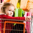 Girl in handcart — Stock Photo