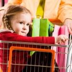 Girl in handcart — Stock Photo