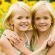 Hugging sisters — Stock Photo