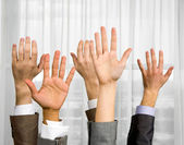 Raised hands — Stock Photo