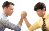 Profiles of two businessmen looking at each other during arm wrestling — Stock Photo