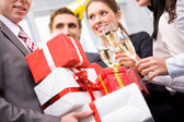 Giftboxes in hands — Stock Photo