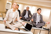 Meditating business partners — Stock Photo