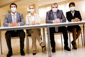 Team with protective masks — Stock Photo