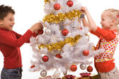 Decorating New Year tree — Stock Photo