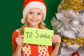 Happy girl holding letter with note 'To Santa' — Stock Photo