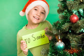 Happy lad holding letter with note 'To Santa' — Stock Photo