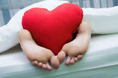 Feet with heart — Stock Photo