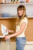 Woman ironing — Stock Photo